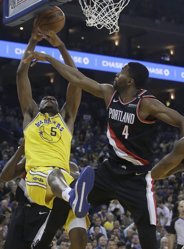 Golden State Warriors forward Kevon Looney (5) reaches for the ball next to Portland Trail Blazers forward Maurice Harkless (4) during the first half of an NBA basketball game in Oakland, Calif. (AP Photo/Jeff Chiu)