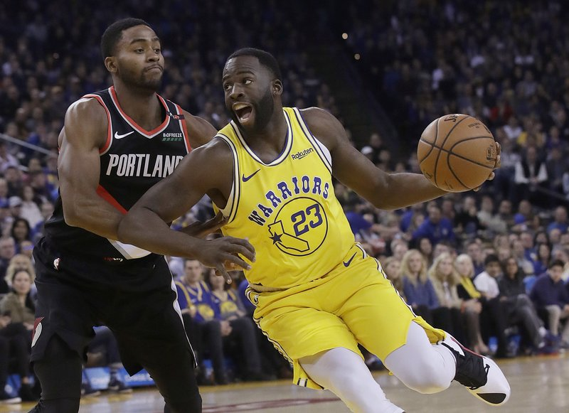 Golden State Warriors forward Draymond Green (23) drives to the basket against Portland Trail Blazers forward Maurice Harkless during the first half of an NBA basketball game in Oakland, Calif. (AP Photo/Jeff Chiu)