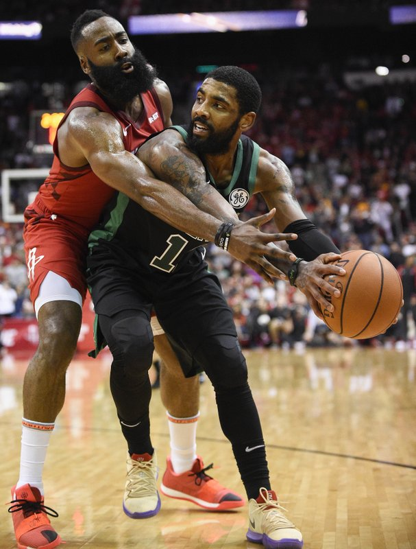Boston Celtics guard Kyrie Irving, right, looks to pass as Houston Rockets guard James Harden defends during the second half of an NBA basketball game, Thursday, Dec. (AP Photo/Eric Christian Smith)