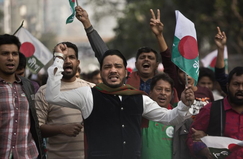 Supporters of Bangladesh Awami League shout slogans during an election rally ahead of the general elections in Dhaka, Bangladesh, Thursday, Dec. (AP Photo/Anupam Nath)