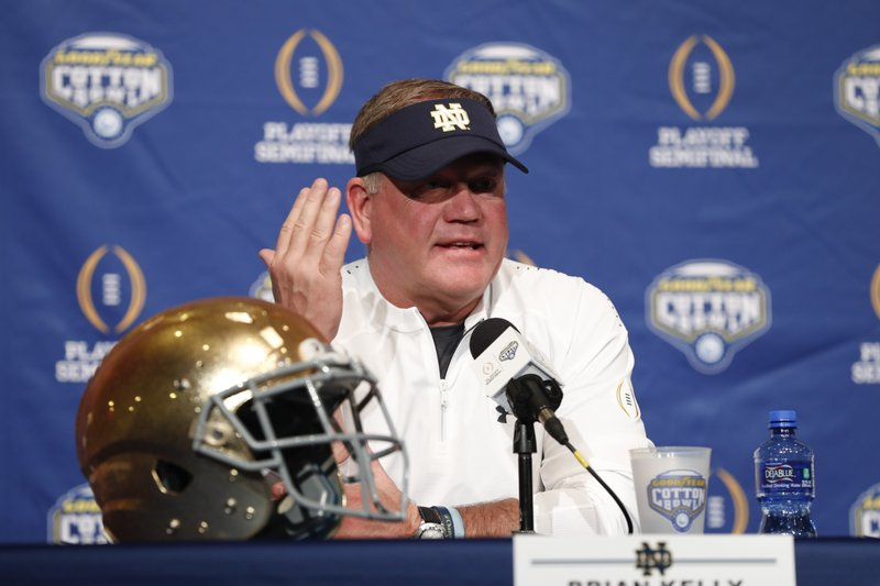 Notre Dame head coach Brian Kelly responds to questions during a news conference at AT&T Stadium in Arlington, Texas, Monday, Dec. (AP Photo/Jim Cowsert)