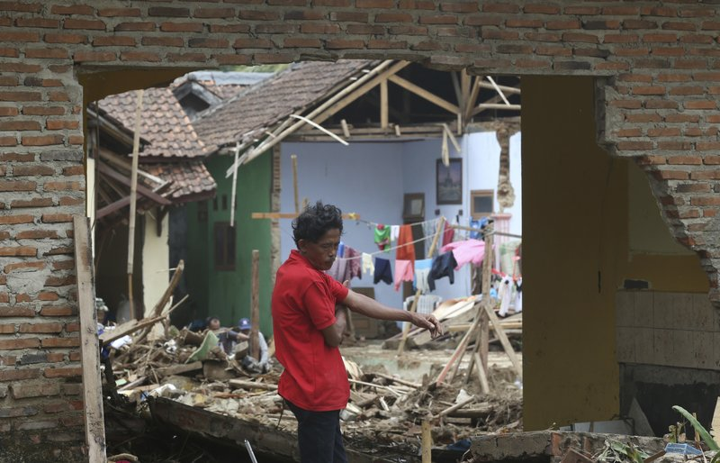 A man views the destruction to his home in the tsunami-hit village of Carita, Indonesia, Friday, Dec. (AP Photo/Achmad Ibrahim)
