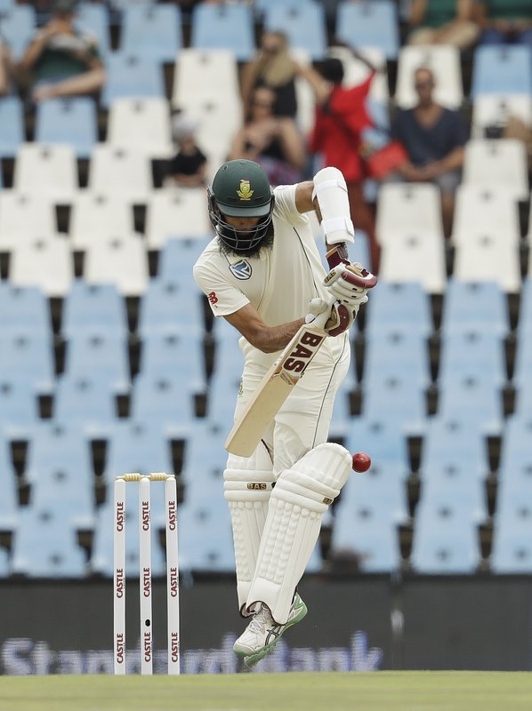 South Africa's batsman Hashim Amla bats on day three of the first cricket test match between South Africa and Pakistan at Centurion Park in Pretoria, South Africa, Friday, Dec. (AP Photo/Themba Hadebe)
