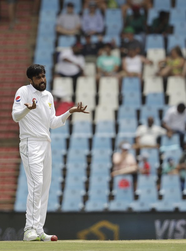 Pakistan's bowler Mohammad Amir gestures to the umpire after unsuccessful appealing for LBW on day three of the first cricket test match between South Africa and Pakistan at Centurion Park in Pretoria, South Africa, Friday, Dec. (AP Photo/Themba Hadebe)