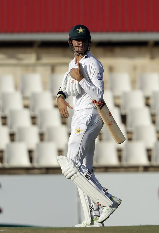 Pakistan's batsman Shaheen Afridi leaves the field after dismissed by South Africa's bowler Duanne Olivier for 4 runs on day two of the first cricket test match between South Africa and Pakistan at Centurion Park in Pretoria, South Africa, Thursday, Dec. (AP Photo/Themba Hadebe)