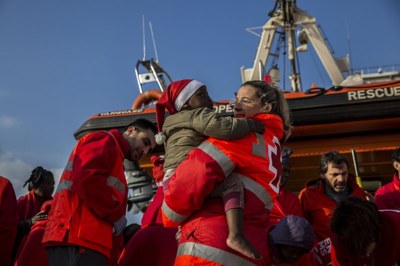 A migrant child is carried from the Spanish NGO Proactiva Open Arms rescue vessel, after being rescued Dec. (AP Photo/Olmo Calvo)