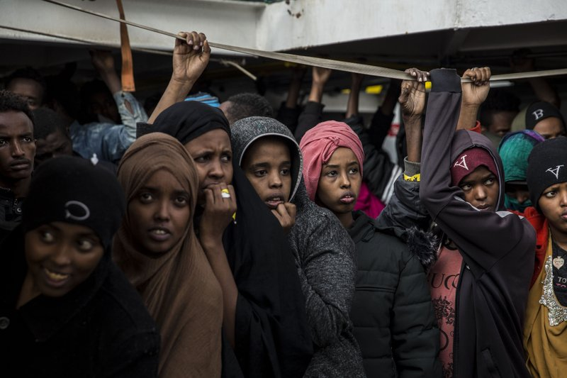 Migrants look out as they approach port, from the deck of the Spanish NGO Proactiva Open Arms rescue vessel, after being rescued Dec. (AP Photo/Olmo Calvo)
