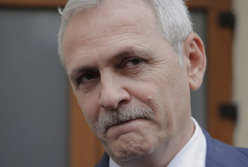 FILE - In this April 27, 2018 file photo, the leader of Romania's ruling Social Democratic party, Liviu Dragnea, walks out of the anti-corruption prosecutors' office, in Bucharest. (AP Photo/Vadim Ghirda, FILE)