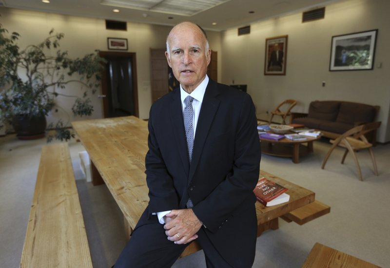 FILE - In this May 28, 2014, file photo, Gov. Jerry Brown poses in his Capitol office in Sacramento, Calif. (AP Photo/Rich Pedroncelli, File)