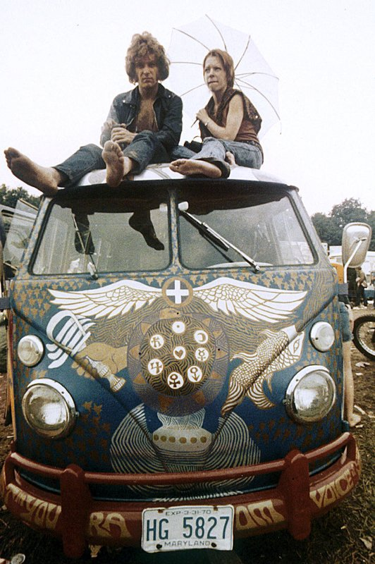 FILE - In this August 1969 file photo, concert-goers sit on the roof of a Volkswagen bus at the Woodstock Music and Arts Fair at Bethel, N. (AP Photo, File)
