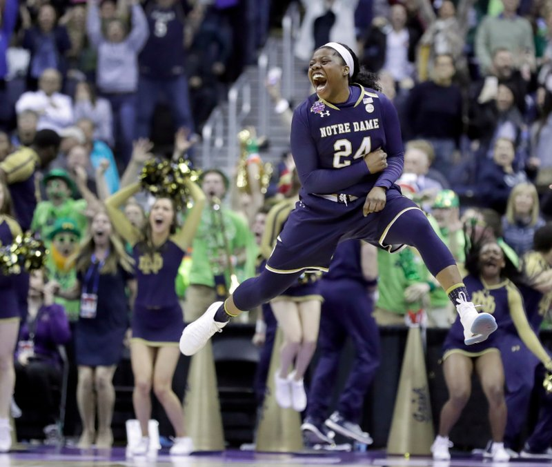 FILE - In this March 30, 2018, file photo, Notre Dame's Arike Ogunbowale celebrates after making the game-winning basket during overtime against Connecticut in the semifinals of the women's NCAA Final Four college basketball tournament in Columbus, Ohio. (AP Photo/Ron Schwane, File)