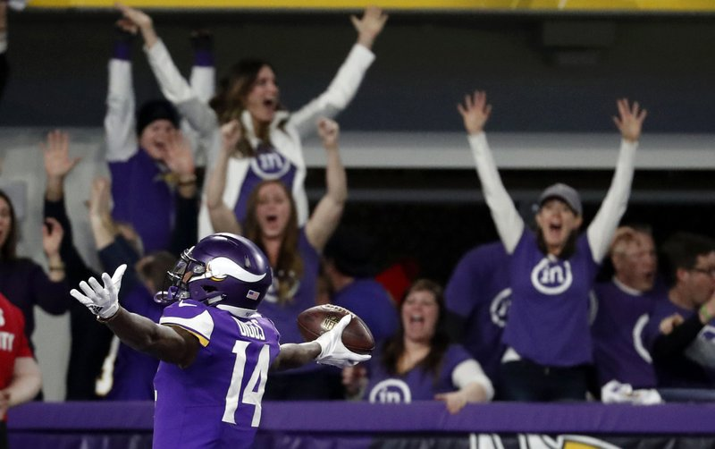 FILE - In this Jan. 14, 2018, file photo, Minnesota Vikings wide receiver Stefon Diggs (14) celebrates in the end zone after a making the game-winning touchdown against the New Orleans Saints late in the second half of an NFL divisional football playoff game in Minneapolis. (AP Photo/Jeff Roberson, File)