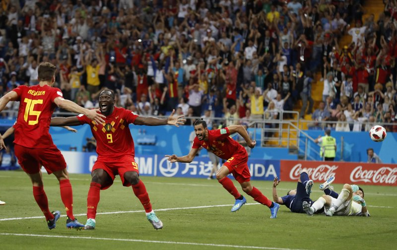 FILE - In this July 2, 2018, file photo, Belgium's Nacer Chadli, center, an his teammates, left, celebrate after Chadli scored his third side's goal during the round of 16 match between against Japan at the 2018 soccer World Cup in the Rostov Arena, in Rostov-on-Don, Russia. (AP Photo/Rebecca Blackwell, File)
