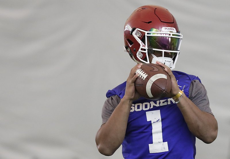 Oklahoma quarterback Kyler Murray sets back to pass during an NCAA college football practice Thursday, Dec. (AP Photo/Brynn Anderson)