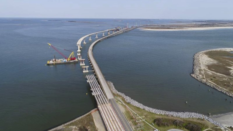 In this April 2018 photo released by the North Carolina Department of Transportation, shows progress on a new Bonner Bridge that will span the Oregon Inlet on North Carolina's Outer Banks. (North Carolina Department of Transportation via AP)