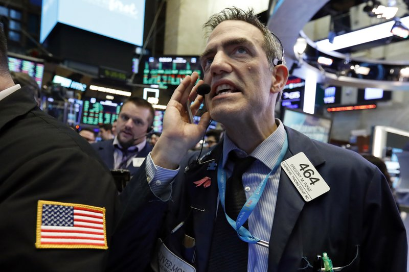 Trader Gregory Rowe works on the floor of the New York Stock Exchange, Friday, Dec. 28, 2018. Stocks are opening higher Friday as U. (AP Photo/Richard Drew)