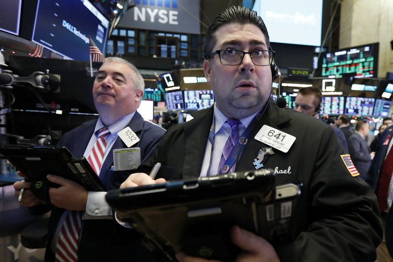 Trader Michael Capolino, right, works on the floor of the New York Stock Exchange, Friday, Dec. 28, 2018. (AP Photo/Richard Drew)