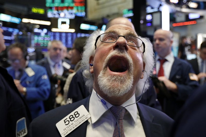 Trader Peter Tuchman works on the floor of the New York Stock Exchange, Friday, Dec. 28, 2018. Stocks are opening higher Friday as U. (AP Photo/Richard Drew)