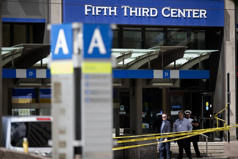 FILE - In this Sept. 6, 2018 file photo, police investigate outside Fifth Third Bank building on Fountain Square after a shooting with multiple fatalities in downtown Cincinnati. (Albert Cesare/The Cincinnati Enquirer via AP, File)