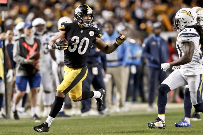 File- This Dec. 2, 2018, file photo shows Pittsburgh Steelers running back James Conner (30) playing in an NFL football game against the Los Angeles Chargers, in Pittsburgh. (AP Photo/Don Wright, File)