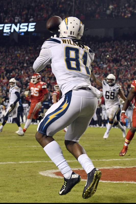 File-This Dec. 13, 2018, file photo shows Los Angeles Chargers wide receiver Mike Williams (81) catches a two-point conversion for the win against the Kansas City Chiefs during the second half of an NFL football game in Kansas City, Mo. (AP Photo/Ed Zurga, File)