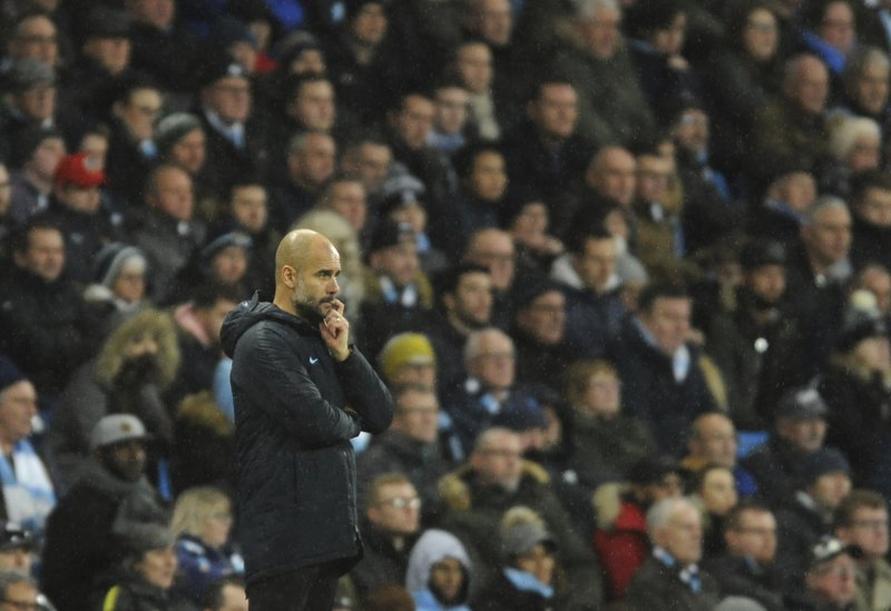Manchester City manager Josep Guardiola follows the game during the English Premier League soccer match between Manchester City and Crystal Palace at Etihad stadium in Manchester, England, Saturday, Dec. (AP Photo/Rui Vieira)