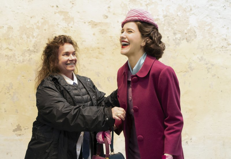 This image released by Amazon shows costume designer Donna Zakowska, left, with actress Rachel Brosnahan on the set of