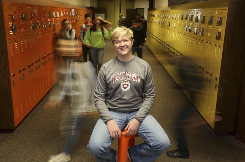 Ulysses High School senior Braxton Moral sits for a portrait at the school in Ulysses, Kan., on Wednesday, Dec. (Sandra J. Milburn/The Hutchinson News via AP)