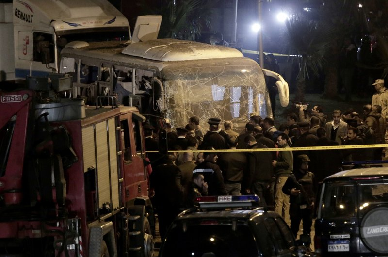 Security forces stand near a tourist bus after a roadside bomb in an area near the Giza Pyramids in Cairo, Egypt. (AP Photo/Nariman El-Mofty)