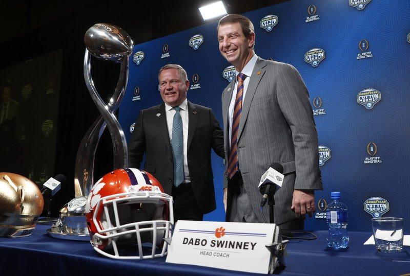 Notre Dame head coach Brian Kelly, left, and Clemson head coach Dabo Swinney smile after concluding the NCAA Cotton Bowl football coaches' news conference in Dallas, Friday, Dec. (AP Photo/LM Otero)