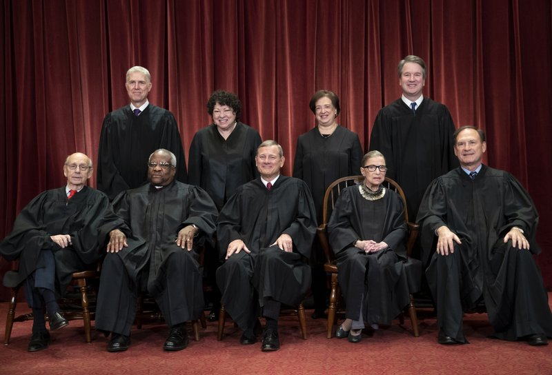 FILE - In this Nov. 30, 2018, file photo, the justices of the U.S. Supreme Court gather for a formal group portrait   at the Supreme Court Building in Washington. (AP Photo/J. Scott Applewhite, File)