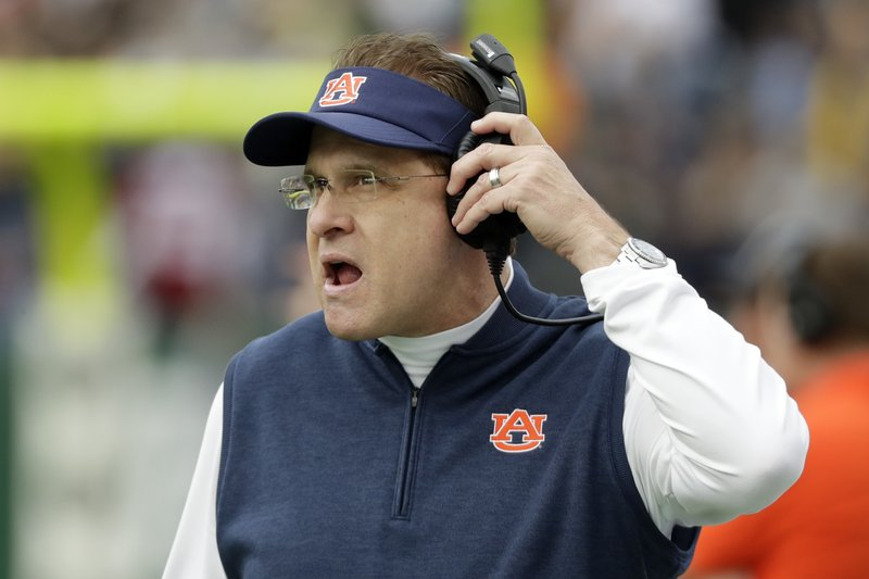 Auburn head coach Gus Malzahn watches from the sideline in the first half of the Music City Bowl NCAA college football game between Auburn and Purdue Friday, Dec. (AP Photo/Mark Humphrey)