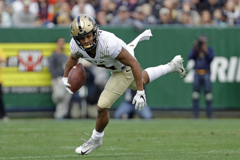 Purdue wide receiver Rondale Moore carries the ball against Auburn in the first half of the Music City Bowl NCAA college football game Friday, Dec. (AP Photo/Mark Humphrey)