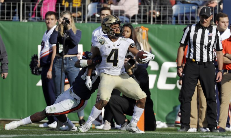 Purdue wide receiver Rondale Moore (4) scores a touchdown past Auburn defensive back Javaris Davis (13) on a 7-yard run in the first half of the Music City Bowl NCAA college football game Friday, Dec. (AP Photo/Mark Humphrey)