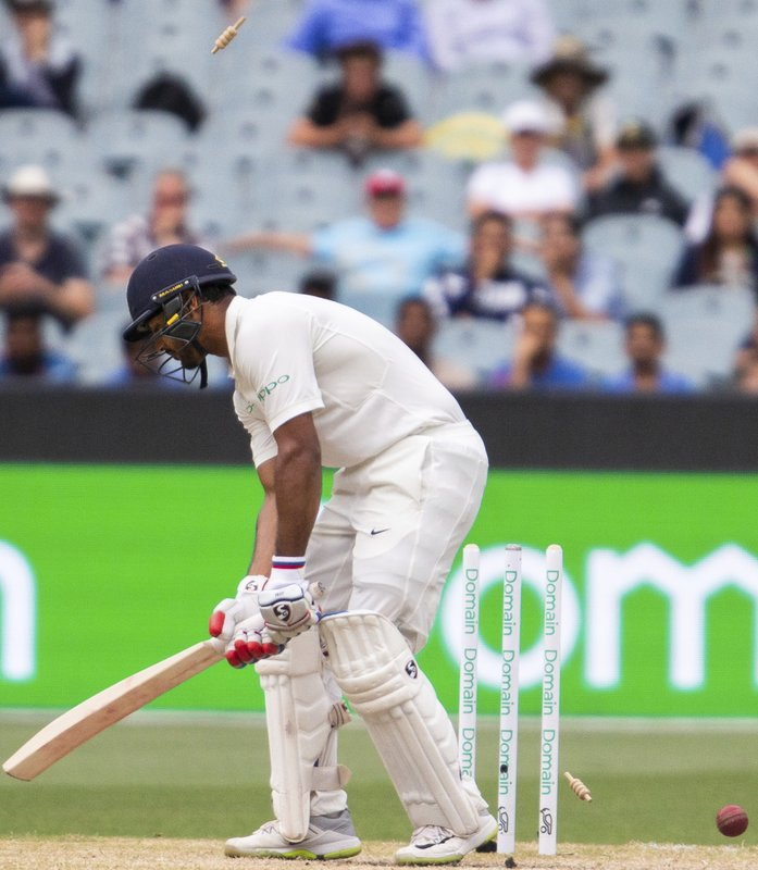 India's Mayank Agarwal gets bowled by Pat Cummins during play on day four of the third cricket test between India and Australia in Melbourne, Australia, Saturday, Dec. (AP Photo/Asanka Brendon Ratnayake)