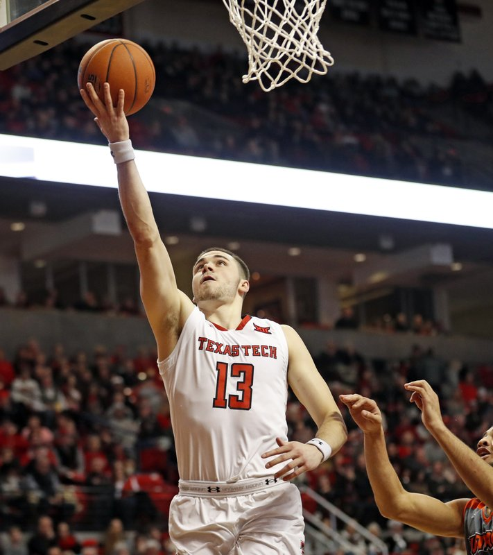 Texas Tech's Matt Mooney (13) lays up the ball during the first half of an NCAA college basketball game against Texas-Rio Grande Valley, Friday, Dec. (AP Photo/Brad Tollefson)