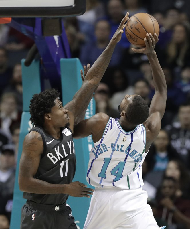 Brooklyn Nets' Ed Davis (17) blocks a shot by Charlotte Hornets' Michael Kidd-Gilchrist (14) during the first half of an NBA basketball game in Charlotte, N. (AP Photo/Chuck Burton)