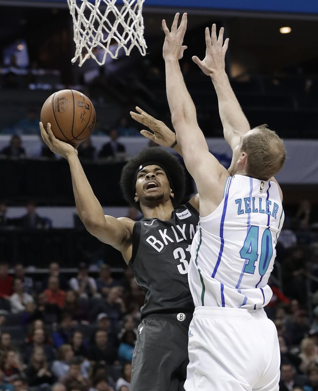 Brooklyn Nets' Jarrett Allen (31) shoots against Charlotte Hornets' Cody Zeller (40) during the first half of an NBA basketball game in Charlotte, N. (AP Photo/Chuck Burton)