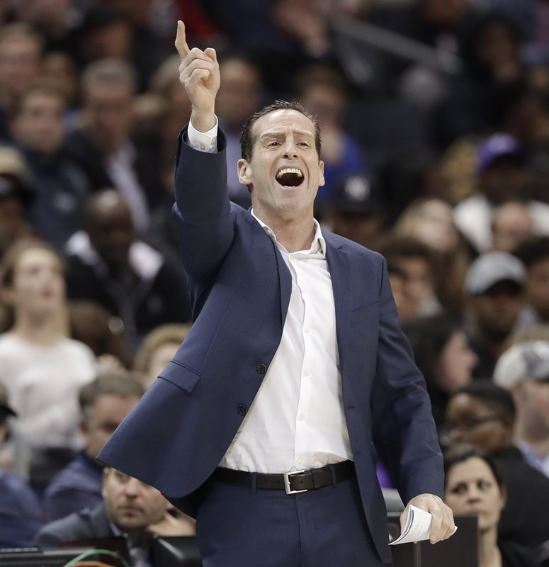Brooklyn Nets coach Kenny Atkinson gestures during the first half of the team's NBA basketball game against the Charlotte Hornets in Charlotte, N. (AP Photo/Chuck Burton)