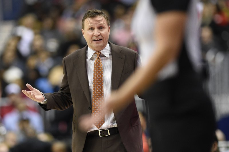 Washington Wizards head coach Scott Brooks gestures during the second half of an NBA basketball game against the Chicago Bulls, Friday, Dec. (AP Photo/Nick Wass)