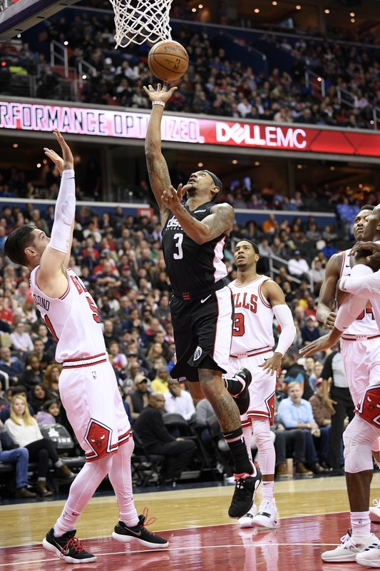 Washington Wizards guard Bradley Beal, center, goes to the basket against Chicago Bulls guard Ryan Arcidiacono (51) and guard Shaquille Harrison, back right, during the first half of an NBA basketball game, Friday, Dec. (AP Photo/Nick Wass)
