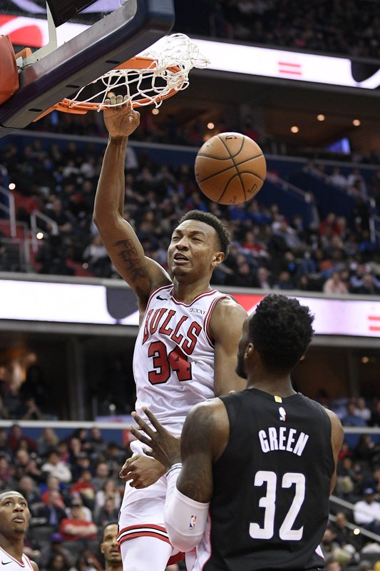 Chicago Bulls forward Wendell Carter Jr. (34) dunks over Washington Wizards forward Jeff Green (32) during the second half of an NBA basketball game, Friday, Dec. (AP Photo/Nick Wass)