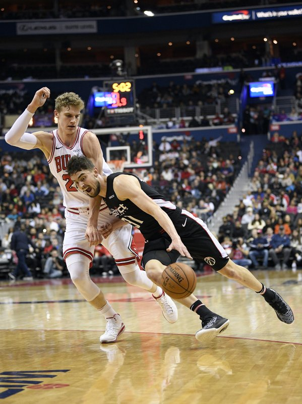 Washington Wizards guard Tomas Satoransky (31), of the Czech Republic, dribbles the ball against Chicago Bulls forward Lauri Markkanen, left, of Finland, during the first half of an NBA basketball game, Friday, Dec. (AP Photo/Nick Wass)