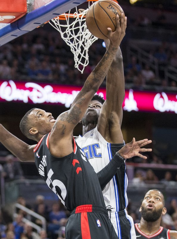 Toronto Raptors guard Delon Wright (55) takes the ball up against Orlando Magic center Mo Bamba (5) during the first half of an NBA basketball game in Orlando, Fla. (AP Photo/Willie J. Allen Jr.)