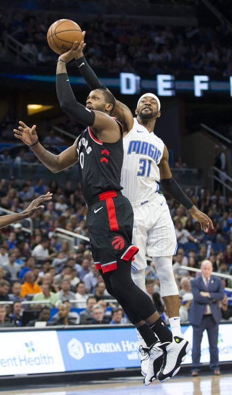Toronto Raptors forward CJ Miles (0) shoots while Orlando Magic guard Terrence Ross (31) tries to block the shot during the first half of an NBA basketball game in Orlando, Fla. (AP Photo/Willie J. Allen Jr.)