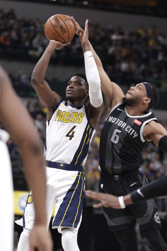 Indiana Pacers guard Victor Oladipo (4) is fouled by Detroit Pistons guard Bruce Brown (6) during the second half of an NBA basketball game in Indianapolis, Friday, Dec. (AP Photo/Michael Conroy)