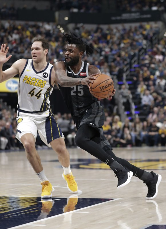 Detroit Pistons guard Reggie Bullock (25) drives on Indiana Pacers forward Bojan Bogdanovic (44) during the first half of an NBA basketball game in Indianapolis, Friday, Dec. (AP Photo/Michael Conroy)