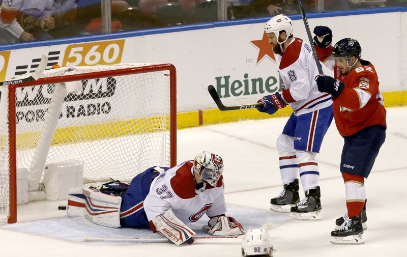 Florida Panthers center Denis Malgin (62) celebrates his first-period goal with Montreal Canadiens goaltender Antti Niemi (37) looking on during an NHL hockey game, Friday, Dec. (AP Photo/Joe Skipper)