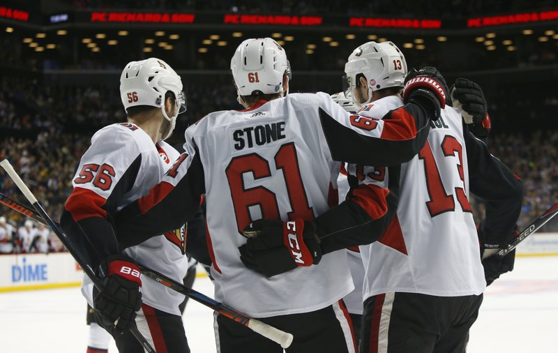 Ottawa Senators right wing Mark Stone (61) celebrates with teammates after scoring a goal against the New York Islanders during the first period of an NHL hockey game, Friday, Dec. (AP Photo/Noah K. Murray)