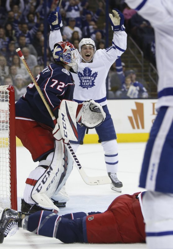 Toronto Maple Leafs' Andreas Johnsson, rear, of Sweden, celebrates a Maple Leafs goal against Columbus Blue Jackets' Sergei Bobrovsky, of Russia, during the first period of an NHL hockey game Friday, Dec. (AP Photo/Jay LaPrete)